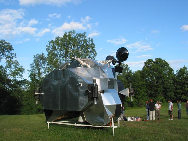 LEM, 2003-2007, 13'X11'X14', aluminum, steel, epoxy, wood, rubber, money Lunar Excursion Module, right rear 3/4 view at Art Omi, 2004