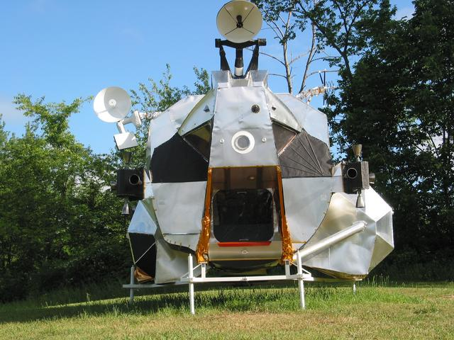 LEM, 2003-2007, 13'X11'X14', aluminum, steel, epoxy, wood, rubber, money Lunar Excursion Module, exterior front