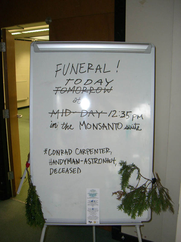 Marker board outside the Monsanto Suite 29 September, 2007.  Monsanto made the nuclear power units used to generate electricity on the moon during Apollo missions.  Now they manufacture GM foods.  Carpenter was a big fan.